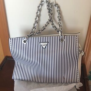 Navy blue and white stripped Guess Purse